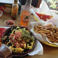 Photo taken at Tito's Burritos by Jeanne A. on 7/27/2012