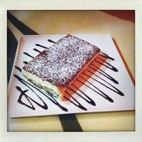Photo taken at Giano Restaurant by Benjamin G. on 5/4/2012