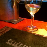 Photo taken at Eclectic Fine Food & Spirits by Gaston H. on 3/12/2012