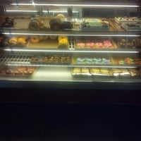 Photo taken at Donut Bank Bakery & Coffee Shop by Dana N. on 8/31/2012