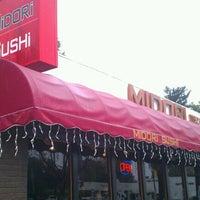 Photo taken at Midori Sushi by Gaston H. on 4/13/2012