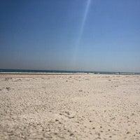 Photo taken at Wilbur-by-the-Sea Beach by Ryan B. on 4/2/2012