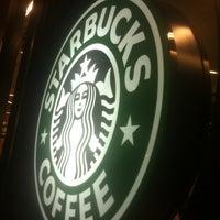 Photo taken at Starbucks by SEZAİ K. on 7/9/2012