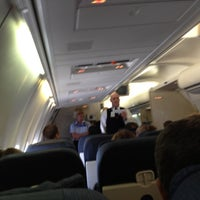 Photo taken at Gate B42 by Aaron G. on 3/22/2012