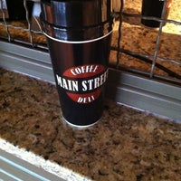 Photo taken at Main Street Coffee & Deli by Nikki T. on 6/4/2012