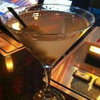 Photo taken at Xhibition Bar by Joe C. on 3/7/2012
