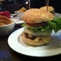 Photo taken at Gourmet Burger Kitchen by Andy L. on 3/15/2012