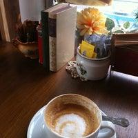 Photo taken at Cafe Vintage by Nicolas O. on 4/19/2012