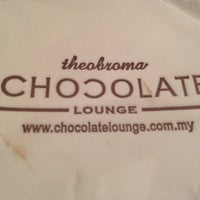 Photo taken at Theobroma Chocolate Lounge by Kelvin C. on 4/13/2012