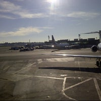 Photo taken at Concourse D by Tania K. on 6/27/2012