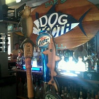 Photo taken at Dogtooth Bar & Grill by Nick L. on 6/29/2012