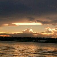 Photo taken at Lago Paranoá by Mi N. on 6/6/2012