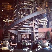 Photo taken at Purple Café & Wine Bar by Rick B. on 2/4/2012