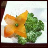 Photo taken at Thai Basil Restaurant by Sarah M. on 3/30/2012