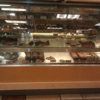 Photo taken at Rocky Mountain Chocolate Factory by Rachel S. on 8/13/2012