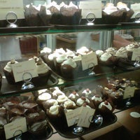 Photo taken at Indulge Cupcake Boutique by Nabby C. on 7/14/2012