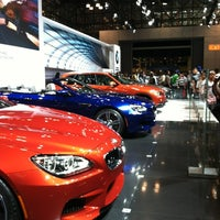 Photo taken at BMW at the NY International Auto Show by Lucy U. on 4/14/2012