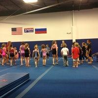 Photo taken at Kingdom Gymnastics by Erica P. on 6/23/2012