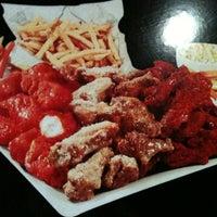 Photo taken at Wingstop by Reno M. on 8/1/2012