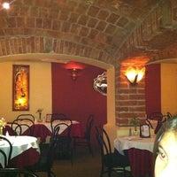 Photo taken at Cluny by Eduardo R. on 2/19/2012