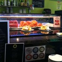 Photo taken at Sushi Eye in Motion by Grace B. on 3/28/2012