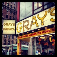 Photo taken at Gray's Papaya by Cathy S. on 2/21/2012