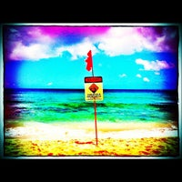 Photo taken at Ehukai Beach by Daniela A. on 6/24/2012