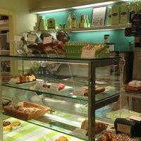 Photo taken at Financier Patisserie by Evelyn F. on 7/28/2012