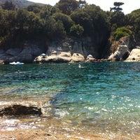Photo taken at Spiaggia del Cotoncello by Fabio M. on 8/10/2012