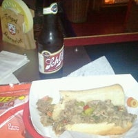 Photo taken at Cigars & Stripes BBQ Lounge by Dale G. on 2/6/2012