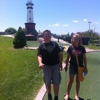 Photo taken at Mulligans Golf & Games by Jennifer C. on 5/21/2012