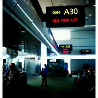 Photo taken at Gate A30 by Teresa d. on 2/8/2012