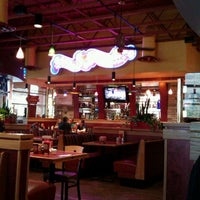 Photo taken at Red Robin Gourmet Burgers by Anna J. on 5/4/2012