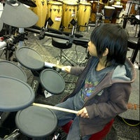 Photo taken at Guitar Center by Poppy M. on 2/22/2012
