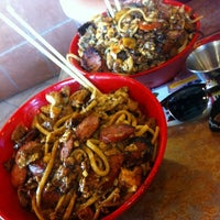 Photo taken at Genghis Grill by Andrew on 8/8/2012