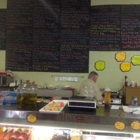 Photo taken at Caruso's Deli by Chris N. on 6/1/2012