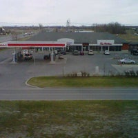 Photo taken at Esso & Tim Hortons by Sebastien R. on 4/8/2012