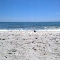 Photo taken at Ponquogue Beach by Neil S. on 6/30/2012