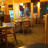Photo taken at Reginelli's Pizzeria by Samantha B. on 2/25/2012
