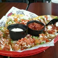 Photo taken at Tijuana Flats by Myshelle A. on 3/30/2012