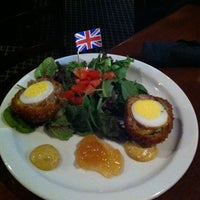 Photo taken at The Lion & Rose British Restaurant & Pub by April S. on 9/1/2012