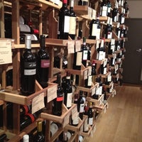 Photo taken at Cork Market & Tasting Room by Ian T. on 2/14/2012