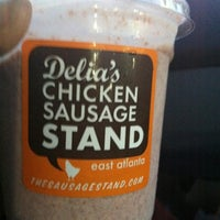Photo taken at Delia's Chicken Sausage Stand by Sharon T. on 5/3/2012