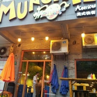 Photo taken at Munchies | 梦奇屋 by Michael M. on 6/26/2012