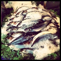 Photo taken at Pike Place Fish Market by Boris L. on 7/26/2012