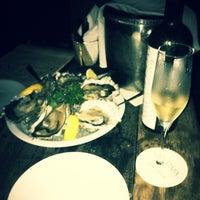 Photo taken at Que Pasa Wine & Tapas by Derek Y. on 3/8/2012