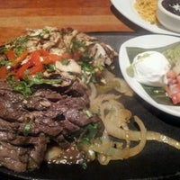 Photo taken at Cantina Laredo by Mercedes S. on 5/18/2012