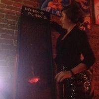 Photo taken at Revolver Bar & Lounge by ashley e. on 7/15/2012