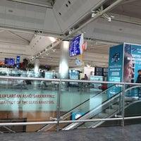 Photo taken at International Terminal Arrival by Metehan K. on 5/11/2012