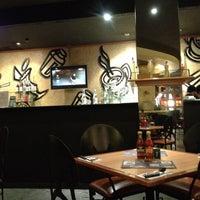Photo taken at Tamani Kafe by Vindo D. on 4/14/2012